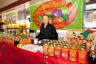 Nick Kreway is shown selling his pickled hot and spicy products from The Pickled Pantry booth at the Downtown Farmers' Market in Las Vegas Friday, December 20, 2013.