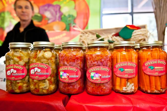 Hot and spicy pickled mushrooms, coleslaw and carrots are among the favorites sold in Nick Kreway's The Pickled Pantry booth at the Downtown Farmers' Market in Las Vegas Friday, December 20, 2013.