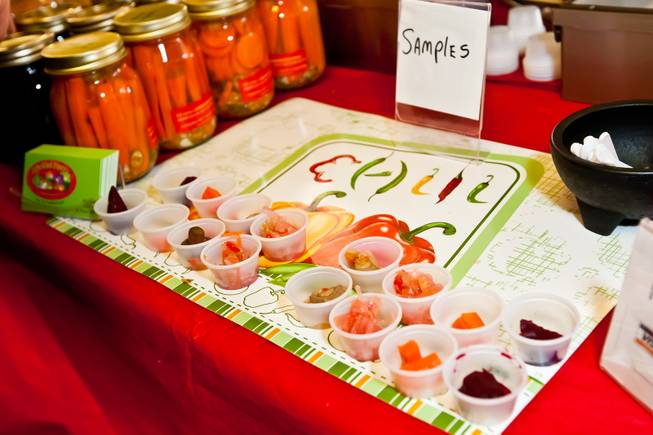 Samples of hot and spicy beets, carrots, coleslaw and mushrooms are offered to customers from The Pickled Pantry's booth at the Downtown Farmers' Market in Las Vegas Friday, December 20, 2013.