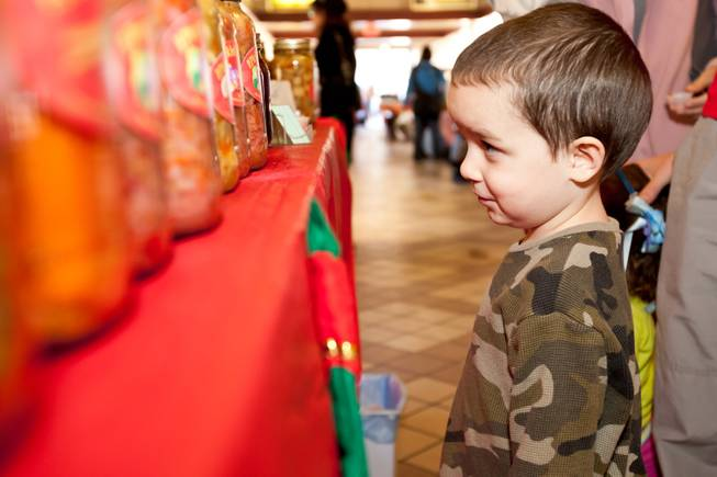 Four-year-old Nathan Meza checks out the pickled products for sale in Nick Kreway's The Pickled Pantry booth at the Downtown Farmers' Market in Las Vegas Friday, December 20, 2013.