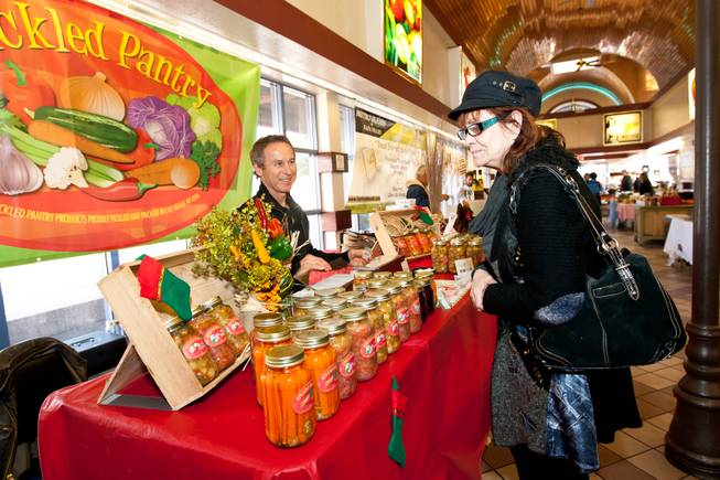 Bonnie Walker peruses the products offered for sale in Nick Kreway's The Pickled Pantry booth at the Downtown Farmers' Market in Las Vegas Friday, December 20, 2013.