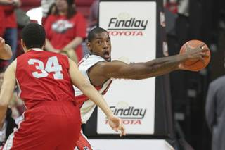 UNLV forward Roscoe Smith holds a rebound away from Sacred Heart during their game Friday, Dec. 20, 2013 at the Thomas & Mack Center.