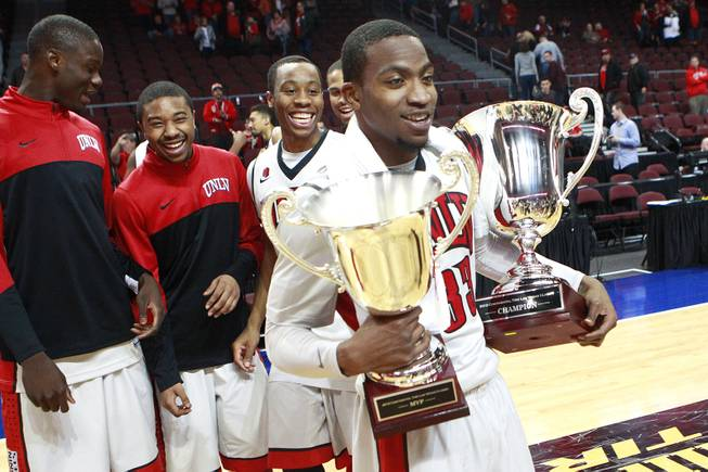 UNLV guard Deville Smith holds the Continental Tire Las Vegas Classic championship trophy and his MVP trophy Monday, Dec. 23 2013, at the Orleans Arena. UNLV beat Mississippi State 82-66.