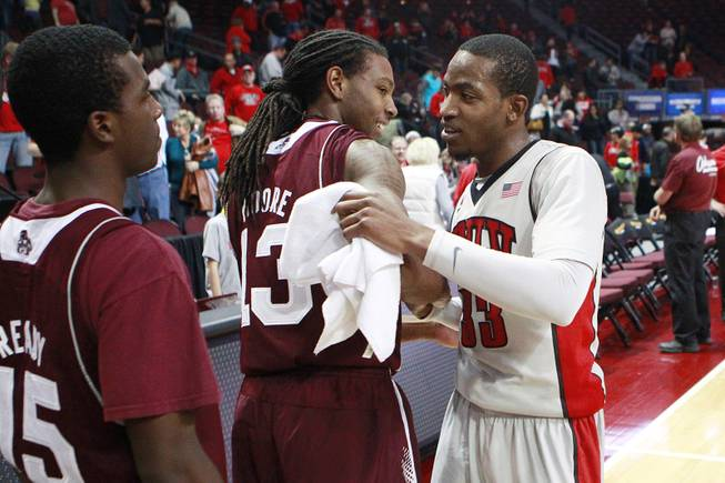 UNLV guard Deville Smith greets former Mississippi State teammate Tevin Moore after their Continental Tire Las Vegas Classic championship game Monday, Dec. 23 2013, at the Orleans Arena. UNLV won the game 82-66.