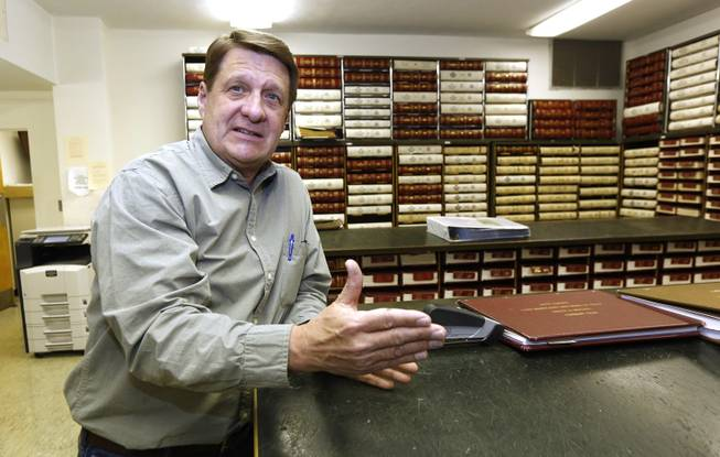 In this Dec. 23, 2013 photograph, Amite County Chancery Clerk Ronnie Taylor talks about the large number of leasing agents that have flocked to the county's antebellum courthouse in Liberty, Miss. The agents review a variety of records to determine land and mineral rights to property that might be on or along the Tuscaloosa Marine Shale formation that may hold billions of barrels of oil.