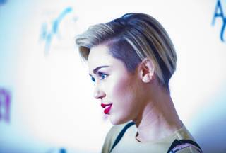 "Miley Cyrus arrives at the red carpet for the grand opening of Britney Spears' ""Britney: Piece of Me"" at Planet Hollywood on Friday, Dec. 27, 2013, in Las Vegas."