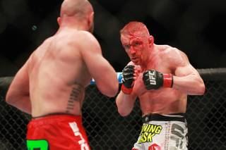 Dennis Siver eyes Manvel Gamburyan during their fight at UFC 168 Saturday, Dec. 28, 2013 at the MGM Grand Garden Arena.