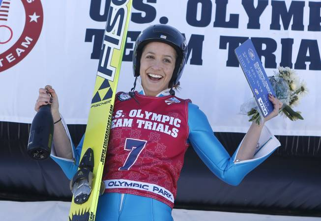First-place finisher Jessica Jerome reacts on the podium after women's ski jumping event  at the U.S. Olympic trials in Park City, Utah, Sunday, Dec. 29, 2013.