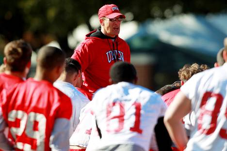 Coach Bobby Hauck talks to his team during UNLV's practice on the campus of Southern Methodist University for the Heart of Dallas Bowl on Monday, Dec. 30, 2013, in Dallas.