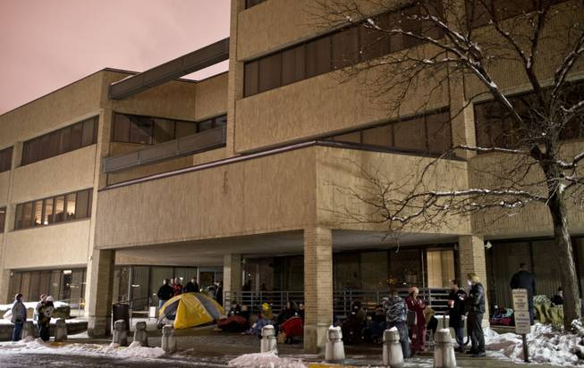 Crowds line up in front of the Salt Lake County Government Complex early Monday morning, Dec. 23, 2013, to obtain marriage licenses upon its opening. By midnight, about 60 people total lined up at two entrances to the complex.