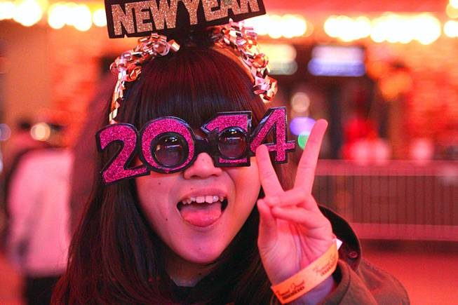 Sakaya of Japan poses during New Year's Eve festivities at the Fremont Street Experience in downtown Las Vegas Tuesday, Dec. 31, 2013. An estimated 335,000 tourists were expected to visit Las Vegas to celebrate the new year.