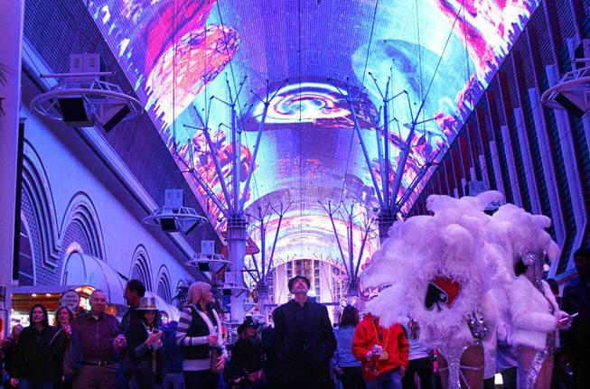 A light show is played during New Year's Eve festivities at the Fremont Street Experience in downtown Las Vegas Tuesday, Dec. 31, 2013. An estimated 335,000 tourists were expected to visit Las Vegas to celebrate the new year.