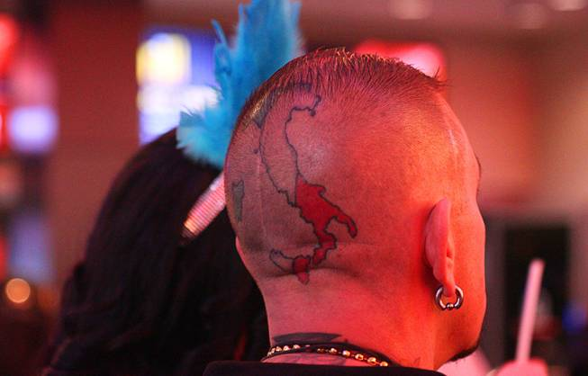 A man with a head tattoo is shown during New Year's Eve festivities at the Fremont Street Experience in downtown Las Vegas Tuesday, Dec. 31, 2013. An estimated 335,000 tourists were expected to visit Las Vegas to celebrate the new year.