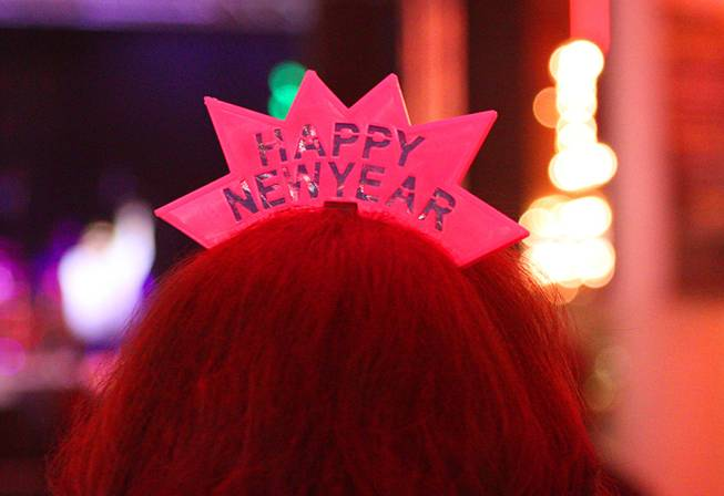 A tiara is shown on the head of a partier during New Year's Eve festivities at the Fremont Street Experience in downtown Las Vegas Tuesday, Dec. 31, 2013. An estimated 335,000 tourists were expected to visit Las Vegas to celebrate the new year.