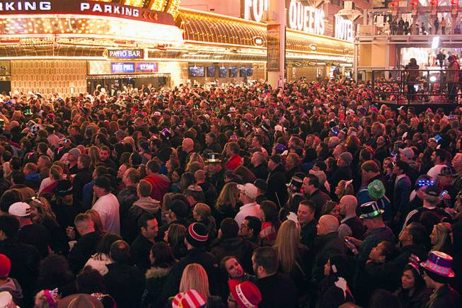 A look at the crowd during New Years Eve festivities at the Fremont Street Experience in downtown Las Vegas Tuesday, Dec. 31, 2013. An estimated 335,000 tourists were expected to visit Las Vegas to celebrate the new year.