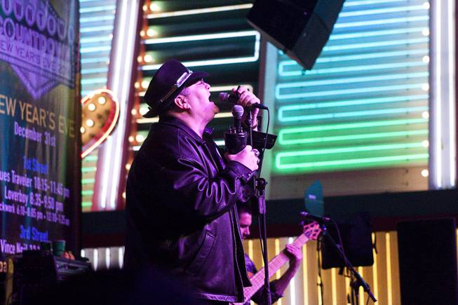 Blues Traveler performs during New Years Eve festivities at the Fremont Street Experience in downtown Las Vegas Tuesday, Dec. 31, 2013. An estimated 335,000 tourists were expected to visit Las Vegas to celebrate the new year.