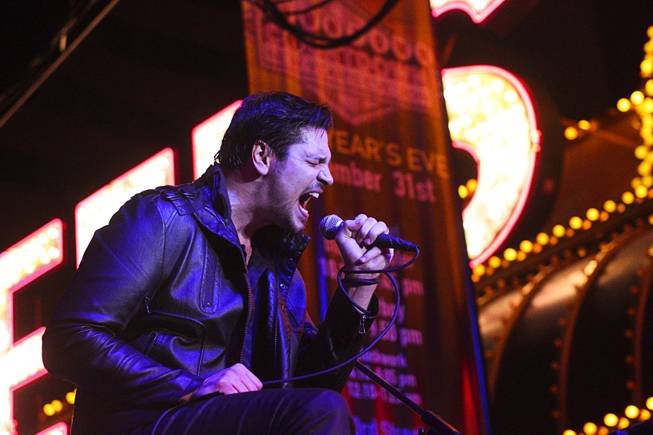 Adelitas Way performs during New Year's Eve festivities at Fremont Street Experience on Tuesday, Dec. 31, 2013,  in downtown Las Vegas. An estimated 335,000 tourists were expected to visit Las Vegas to celebrate the New Year.