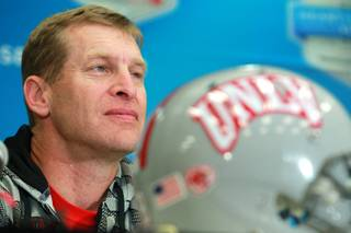 UNLV head coach Bobby Hauck listens to a question during a news conference for the Heart of Dallas Bowl Tuesday, Dec. 31, 2013 at the Cotton Bowl in Dallas.
