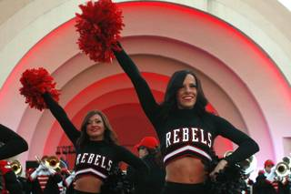 UNLV cheerleaders perform during a pep rally for the Heart of Dallas Bowl Tuesday, Dec. 31, 2013 at the state fairgrounds near the Cotton Bowl in Dallas.