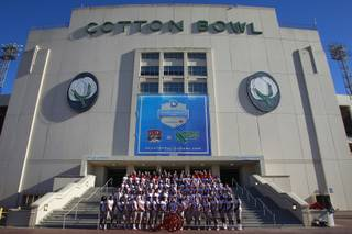 The UNLV football team has their team photo taken for the Heart of Dallas Bowl Tuesday, Dec. 31, 2013 at the Cotton Bowl in Dallas.