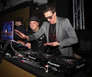 Ryan Lochte, right, with DJ Twisted, hosts at SHe by Morton's on Tuesday, Dec. 31, 2013, in Crystals at CityCenter.