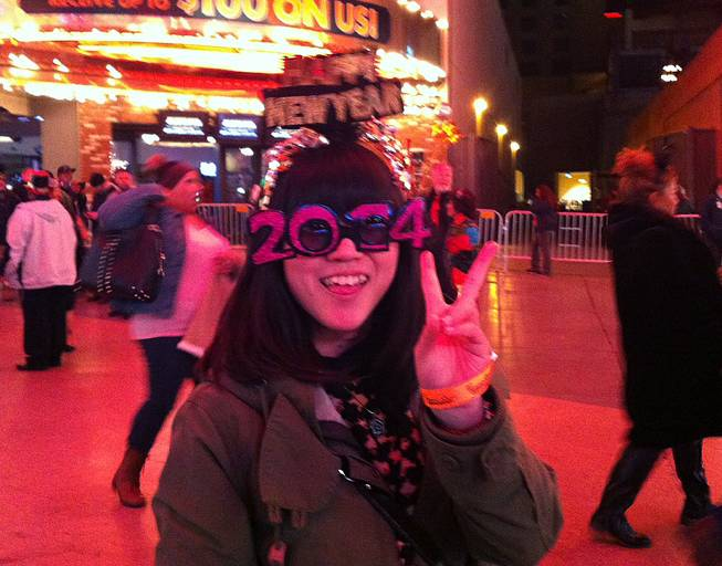 A reveler in downtown Las Vegas enjoys the New Year's Eve festivities, Tuesday, Dec. 31, 2013.