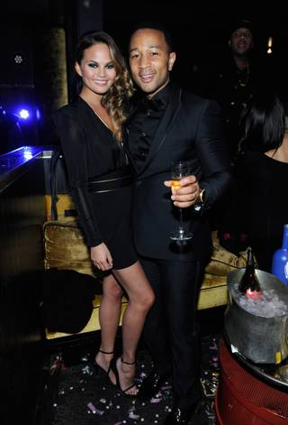 Singer John Legend, with model wife Chrissy Teigen, hosts at Haze on Tuesday, Dec. 31, 2013, in Aria.