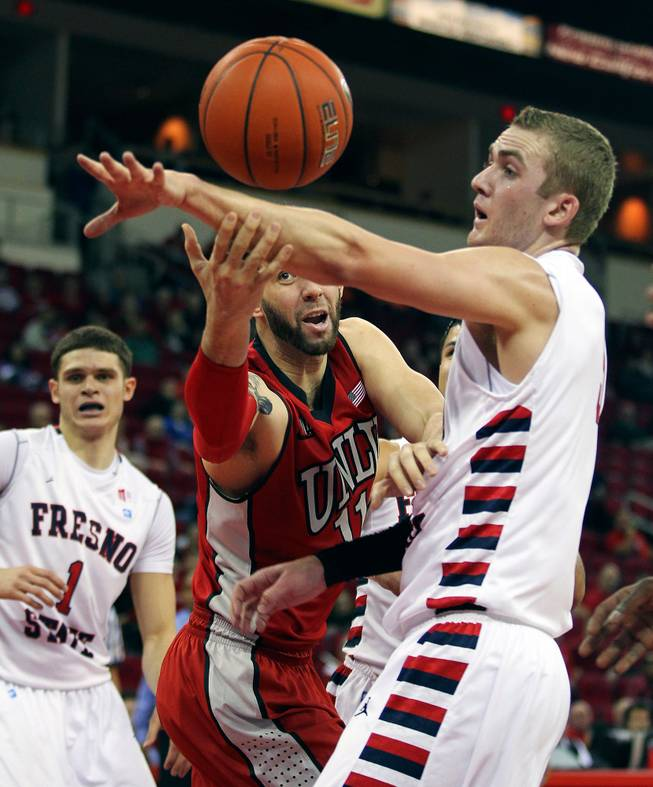 UNLV's Carlos Lopez-Sosa, left, tries to grab a rebound from Fresno State's Tanner Giddings in the first half of a NCAA college basketball game in Fresno, Calif., Wednesday, Jan. 1, 2014.