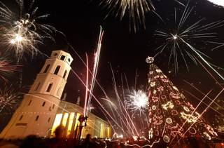 Fireworks light the sky above the Cathedral Square in Vilnius, Lithuania shortly after midnight during the New Year's Eve celebrations, Wednesday, Jan. 1, 2014. Thousands of people celebrated the beginning of the New Year 2014  in the Lithuanian capital.