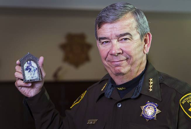 Sheriff Doug Gillespie poses with a photo of Danko, his former police dog, during an interview in Metro Police Headquarters Thursday, Jan. 2, 2014.  Gillespie was a K-9 officer from 1990 to 1993 and adopted  Danko after the dog retired. Danko passed away in 1997.
