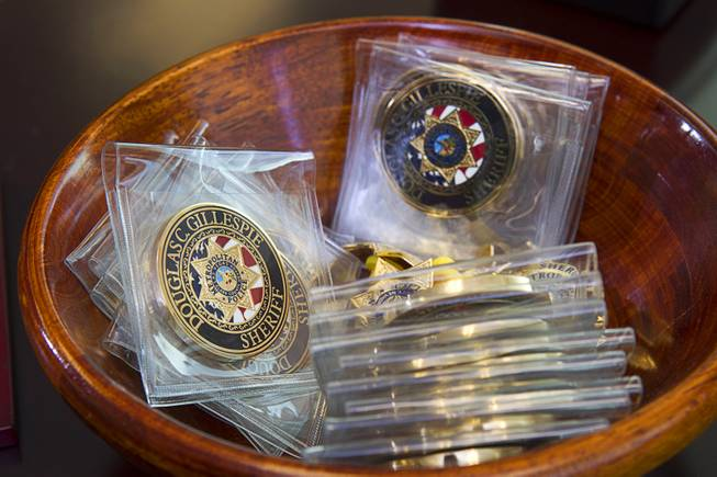 Challenge coins are shown in Sheriff Doug Gillespie's office in Metro Police Headquarters Thursday, Jan. 2, 2014.