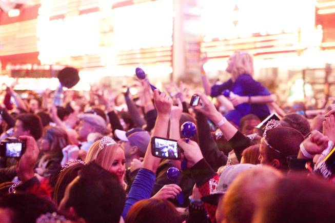 Fans cheer on Papa Roach during New Year's Eve festivities at the Fremont Street Experience in downtown Las Vegas, Dec. 31, 2013. An estimated 335,000 tourists were expected to visit Las Vegas to celebrate the new year.