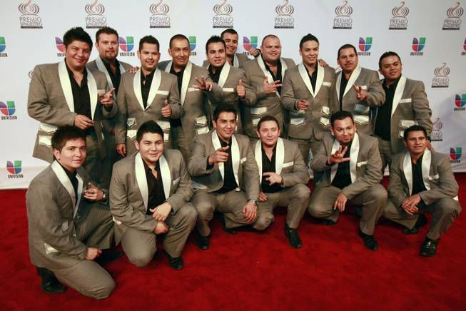 Members of the band La Original Banda el Limon pose on the Red Carpet, Thursday, Feb. 17, 2011 before the start of the Premio lo Nuestro, Latin music award show in Miami.
