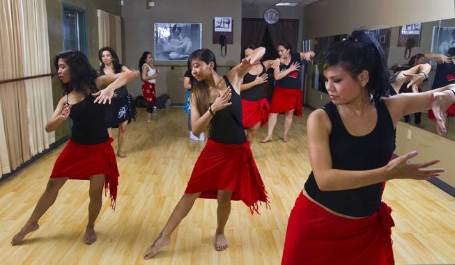 Ladies go through their moves during a hula workout class on Friday, Jan. 3, 2014.
