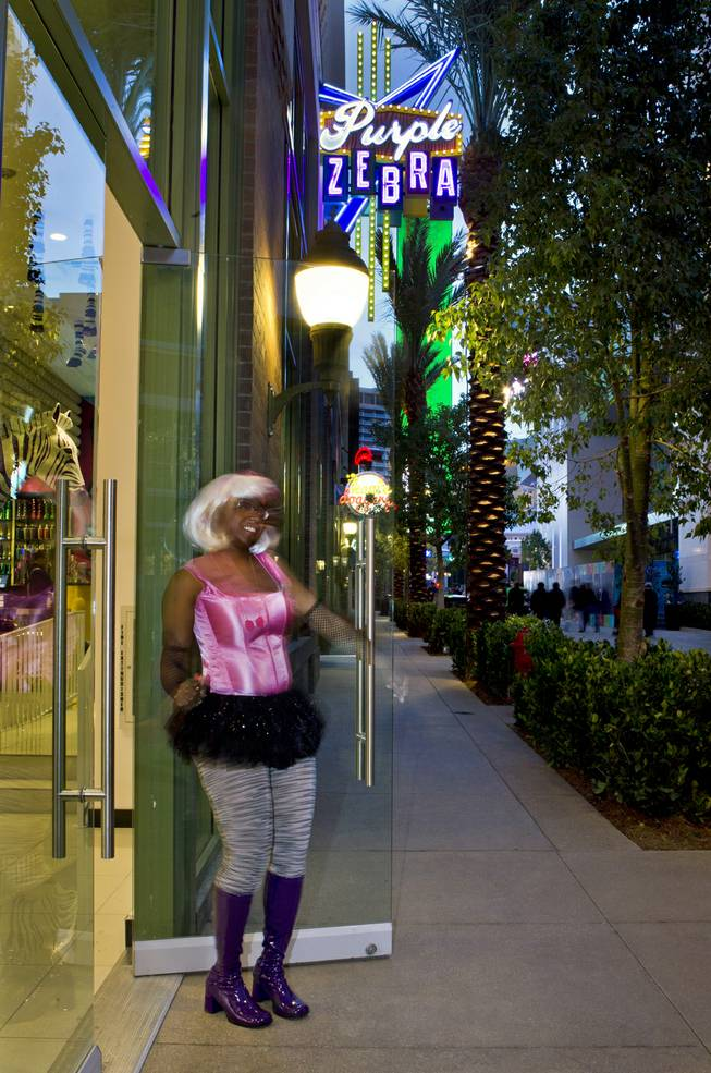 Shatevia Boykin of the Purple Zebra welcomes guests to one of the stores in operation on The Linq shopping and food area between The Quad and The Flamingo on Friday, Jan. 3, 2014.