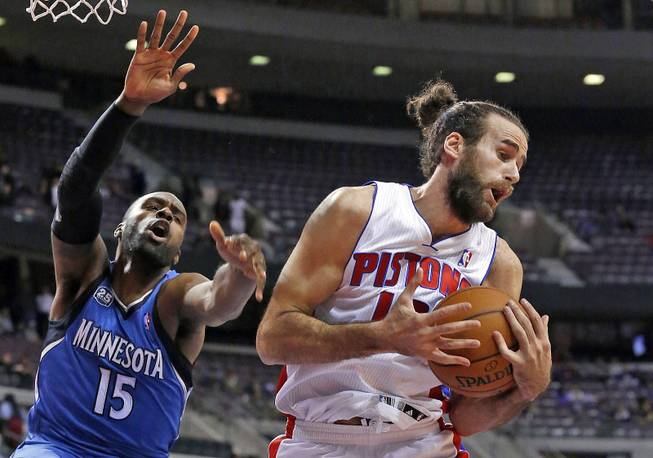 Detroit Pistons small forward Luigi Datome, of Italy, right, pulls down a rebound from Minnesota Timberwolves small forward Shabazz Muhammad (15) in the second half of an NBA basketball game in Auburn Hills, Mich., Tuesday, Dec. 10, 2013.