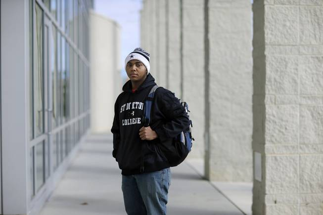 Political science student La'Shon Callaway, 19, of Egg Harbor Township, N.J., poses for a photograph as he stands on the campus of the Richard Stockton College of New Jersey, in Galloway, N.J., Tuesday, Dec. 31, 2013.