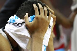 UNLV forward Chris Wood buries his face in a towel during their Mountain West Conference game against Air Force Saturday, Jan. 4, 2014 at the Thomas & Mack Center. Air Force upset UNLV 75-68.