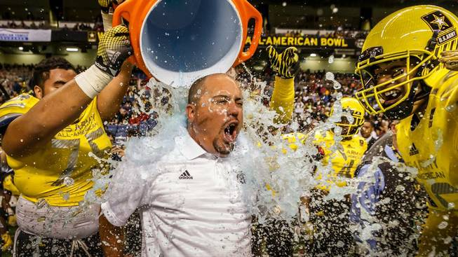 Bishop Gorman High football coach Tony Sanchez was drenched with water after coaching the West to a win in the U.S. Army All-American Bowl in San Antonio.