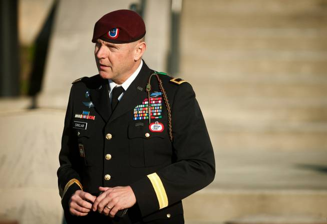 In this Tuesday, Jan. 22, 2013, file photo, Army Brig. Gen. Jeffrey A. Sinclair leaves a Fort Bragg, N.C., courthouse after he deferred entering a plea at his arraignment on charges of fraud, forcible sodomy, coercion and inappropriate relationships.