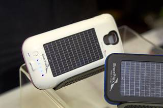 Smartphone cases with solar photovoltaic cells by EnerPlex are displayed during