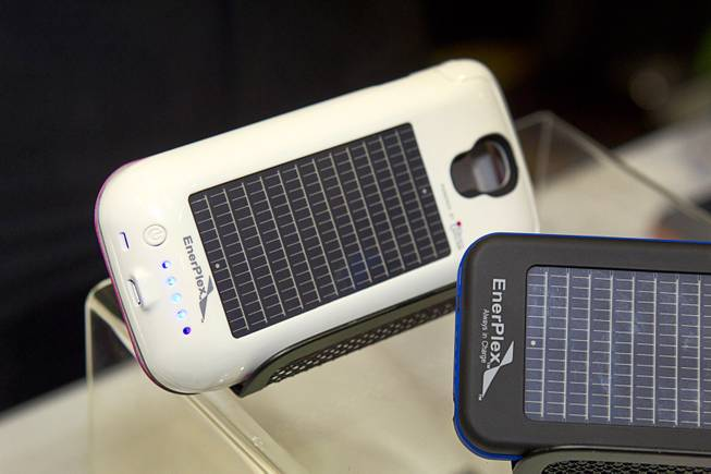 "Smartphone cases with solar photovoltaic cells by EnerPlex are displayed during ""CES Unveiled,"" a media preview event to the annual Consumer Electronics Show (CES), in Las Vegas, Jan. 5, 2014. The cases retail for $89.99-$99.99 depending on the model."