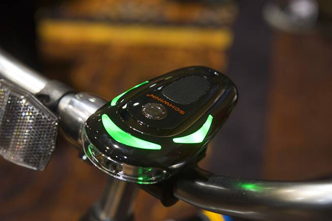 "A Schwinn CycleNav is displayed on a bicycle during ""CES Unveiled,"" a media preview event to the annual Consumer Electronics Show (CES), in Las Vegas, Jan. 5, 2014. The CycleNav links with a smartphone and gives visible and audio directions to the rider."