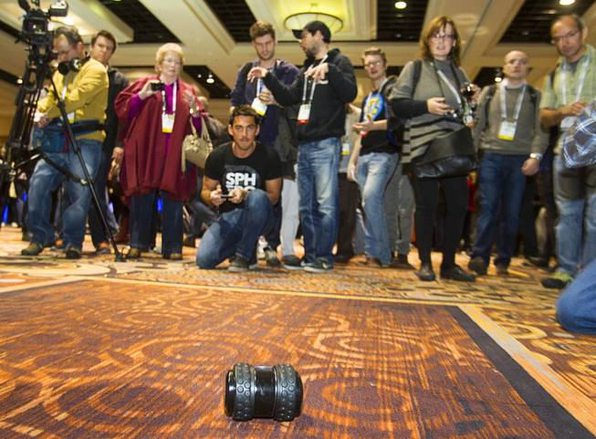 "A Sphero 2B by Orbotix is demonstrated during ""CES Unveiled,"" a media preview event to the annual Consumer Electronics Show (CES), in Las Vegas, Jan. 5, 2014. The toy, estimated to retail for about $100, is controlled with a smartphone and is expected to ship in the fall of 2014, a representative said."