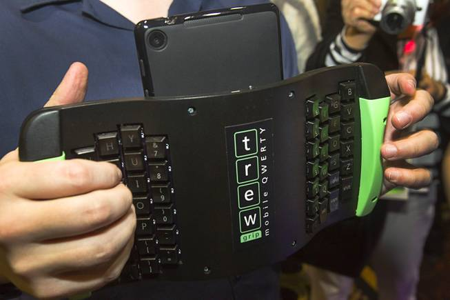 "A TREWGrip keyboard is shown during ""CES Unveiled,"" a media preview event to the annual Consumer Electronics Show (CES), in Las Vegas, Jan. 5, 2014. The keyboard keys face away from the user but allows people to type and enter data into a tablet while standing up."