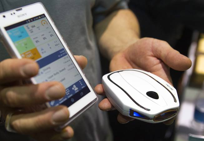 "A Tao WellShell is displayed during ""CES Unveiled,"" a media preview event to the annual Consumer Electronics Show (CES), in Las Vegas, Jan. 5, 2014. The WellShell is an electronic isometric device but also monitors various fitness levels and transmits the data to a smartphone."