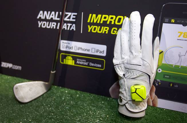 "A Zepp sensor is shown on a golf glove during ""CES Unveiled,"" a media preview event to the annual Consumer Electronics Show (CES), in Las Vegas, Jan. 5, 2014. The sensors, available for golf, baseball and tennis, analyze 1,000 data points per second to create 3D representations of a player's swing, a representative said. The sensors retail for $149.99, he said."