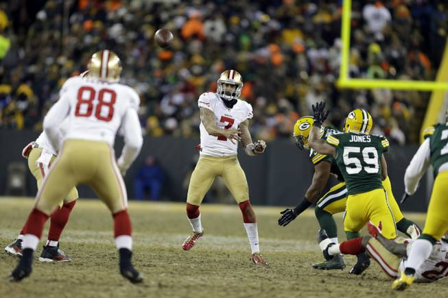 San Francisco 49ers quarterback Colin Kaepernick throws a pass during the second half of an NFL wild-card playoff game against the Green Bay Packers on Sunday, Jan. 5, 2014, in Green Bay, Wis.