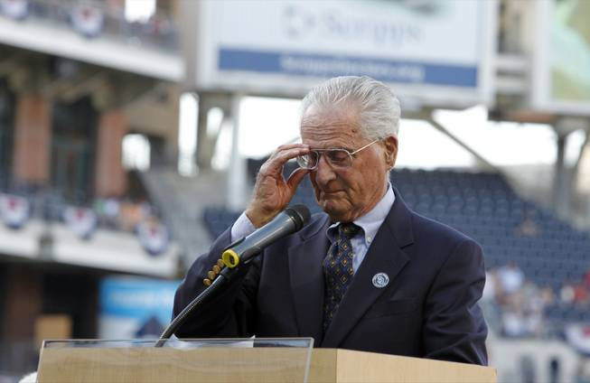 San Diego Padres radio announcer Jerry Coleman holds back tears during a ceremony honoring his 70 years in baseball, 40 of them with the Padres, and to honor for his service in the Marine Corps, before the game between the Padres and the Colorado Rockies in San Diego on Saturday, Sept. 15, 2012.