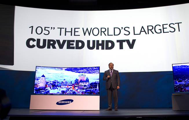 Joe Stinziano, executive vice president of Samsung Electronics of America, introduces a 105-inch, curved UHD television during the International Consumer Electronics Show (CES), in Las Vegas, Monday Jan. 6, 2014.